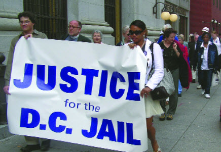 Members of the Coalition for Justice at the D.C. Jail march from St. John's, Lafayette Square to the Mayor's office to demand that the District abide by the Jail Improvement Act of 2003 on Oct. 4, 2005.